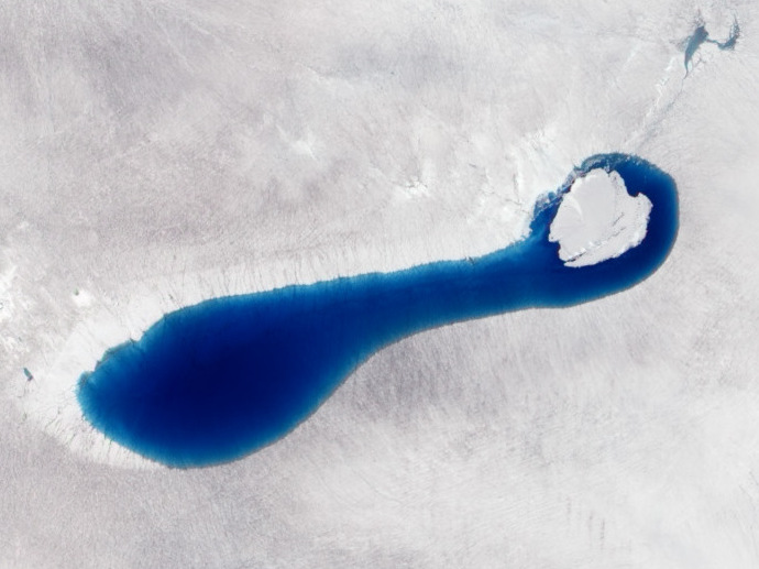 Melt ponds in Greenland. Photo credit: NASA Earth Observatory image by Jesse Allen and Robert Simmon, using EO-1 ALI data from the NASA EO-1 team.